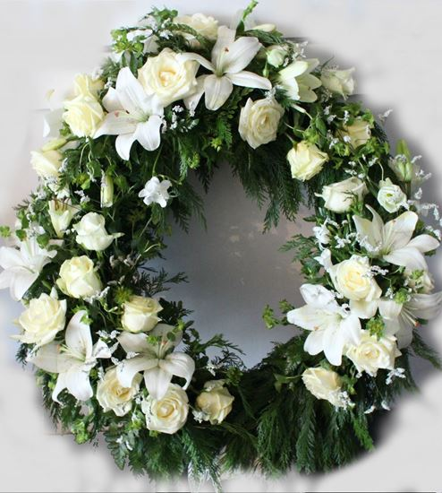 Picture of Funeral Wreath with white-cream blooms elegantly arranged in 3 groupings -3 sizes.