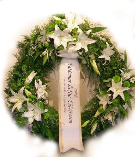 Picture of Funeral Wreath with white roses, lilies and green mums elegantly arranged in 3 groupings-3 sizes.
