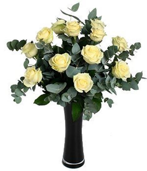 Picture of White-cream coloured long stemmed roses with eucalyptus and greenery.