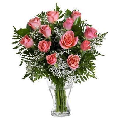 Picture of Romantic flower bouquet with pink roses, baby's  breath and greenery.