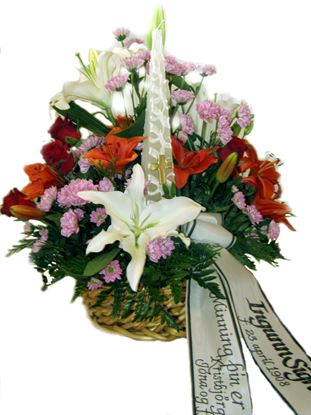 Picture of Sympathy flower arrangement in a basket with candle.