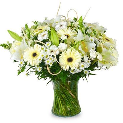 Picture of White and cream coloured bouquet with lilies, moms,  daisies and more..