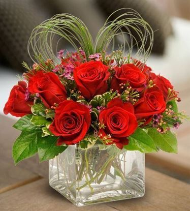 Picture of Romantic red roses arrangement in a container with a twist of a heart.