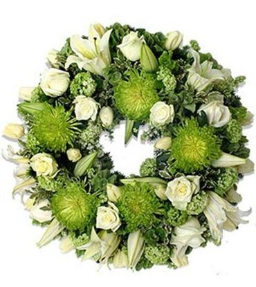 Picture of Fully decorated Funeral Wreath with white lilies, roses and green flowers-3 sizes available.