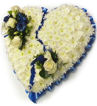 Picture of Fully decorated Funeral heart with white mums,  white roses and blue flowers-2 sizes .