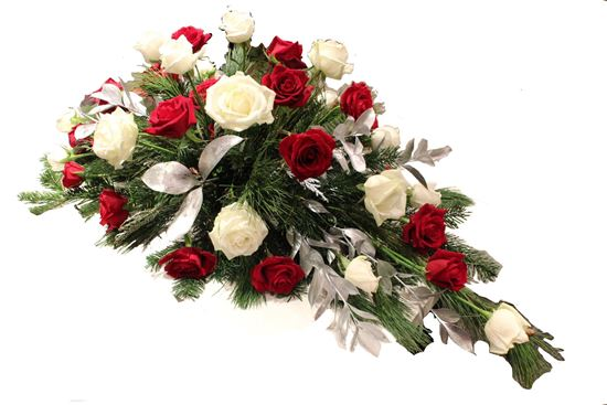Picture of An elegant casket spray with red and white roses, silver leaves and more.