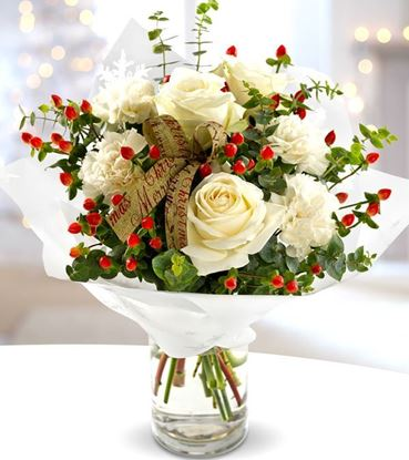 Picture of Christmassy flower bouquet with white roses, red berries, greenery and ribbon