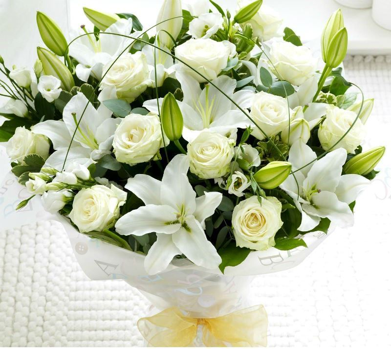 Snow white beauty bouquet with lilies, short stem roses, lisianthus ...