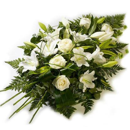 Picture of Funeral tribute flower arrangement with all white mixed flowers and greenery in oasis base.