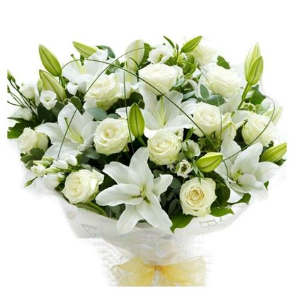 Picture of Snow white beauty bouquet with lilies, short stem roses, lisianthus and greenery.