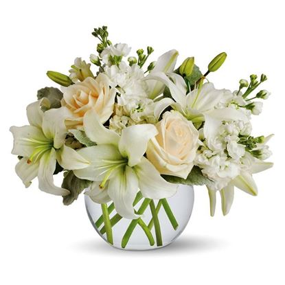 Picture of Calming and an elegant  white lilies and peach roses flower arrangement in vase..