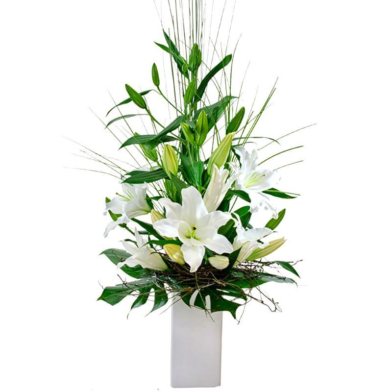 Modern oriental lily flower arrangement in high vase with tropical picture of modern oriental lily flower arrangement in high vase with tropical leaves mightylinksfo