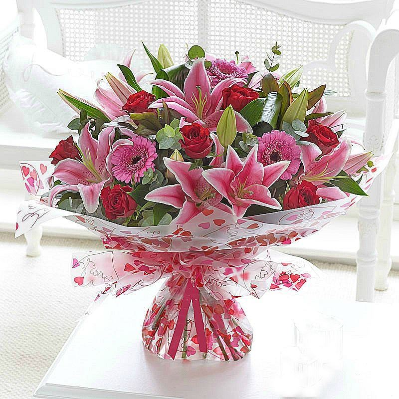 Exquisite bouquet with long stemmed red roses, oriental Lilies ...
