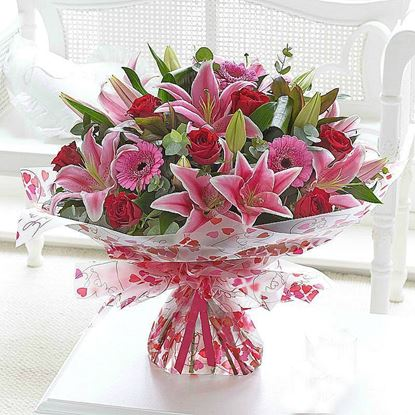 Picture of Exquisite bouquet with long stemmed red roses, oriental Lilies, Gerbera and more.