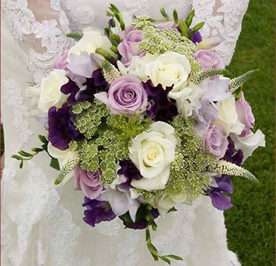 Picture of Sophisticated Wedding bouquet with lilac, purple and white cream blooms.