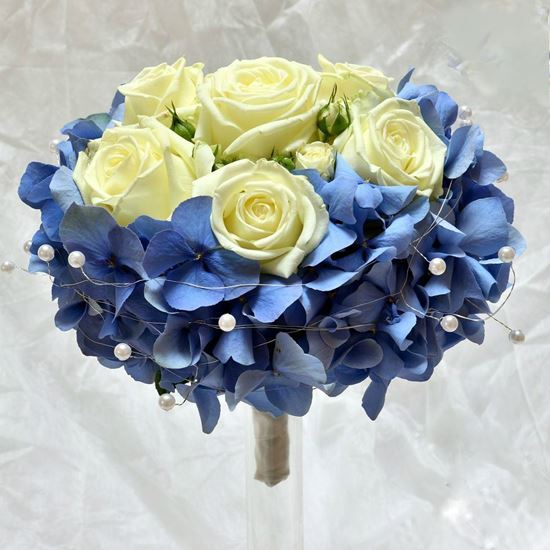 Picture of Wedding  Bridal Bouquet with Blue Hydrangea and cream or white roses.