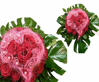 Picture of An amazing bouquet in the shape of heart- red and pink roses and more.