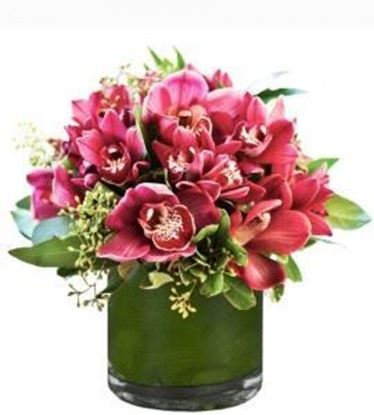 Picture of Beautiful flower arrangement with pink-red  cymbidium orchid and more  in a vase (included).