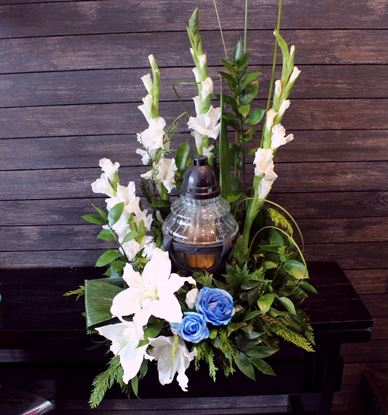 Picture of Farewell stunning  tall urn decoration with gladiola, white roses and more.