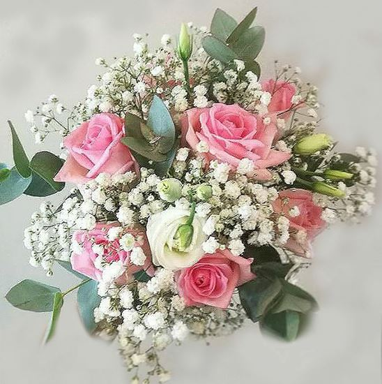 Picture of Wedding bouquet with  pink roses, baby breath, eustoma and eucalypthus.