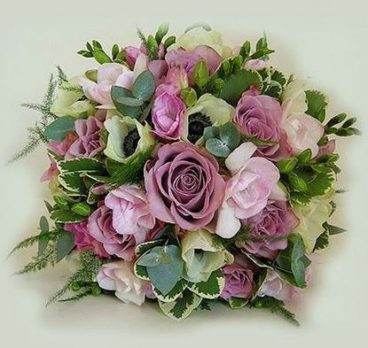 Picture of Wedding bouquet with a blend of lilac, purple and cream blooms.
