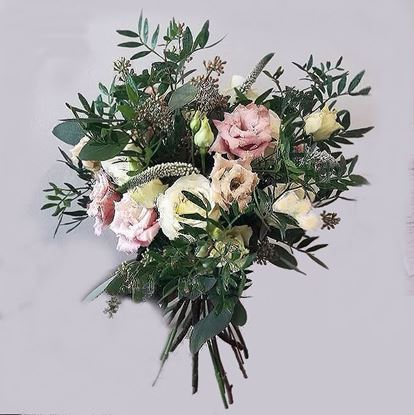 Picture of Wedding bouquet with a blend of peachy-pink, white and cream blooms.