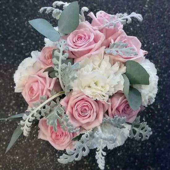 Picture of Coastal style wedding bouquet in soft pastel colors with roses.