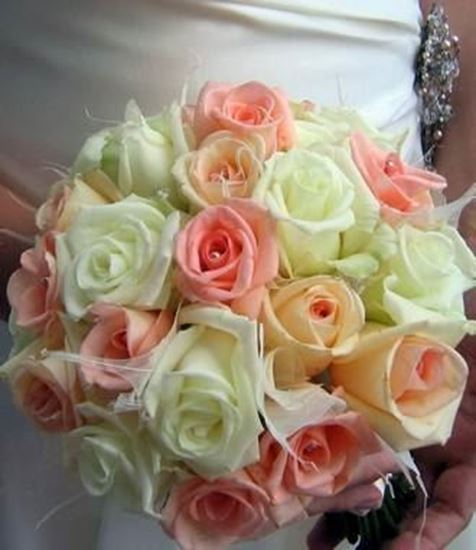 Picture of Romantic Wedding bouquet with all shades of pastel colored roses.