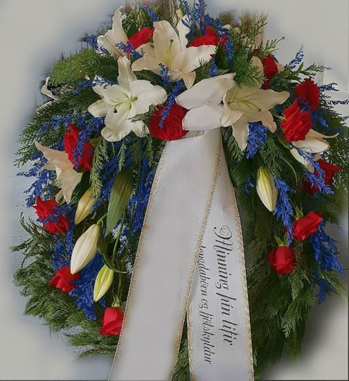 Picture of Funeral Wreath with one decoration with white lilies, blue solidago and red roses-in 3 sizes.