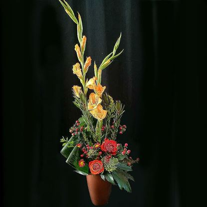 Picture of Very modern and contemporary  arrangement in tall ceramic vase.