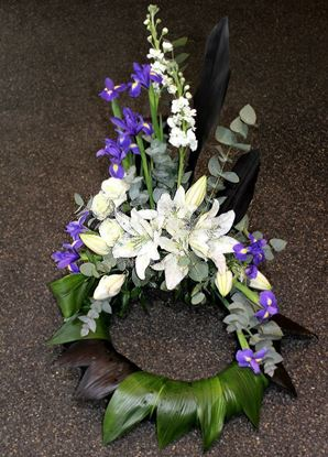 Picture of Danish style of Funeral Wreath standing on the floor with white lilies, blue iris and more- in 3 sizes.