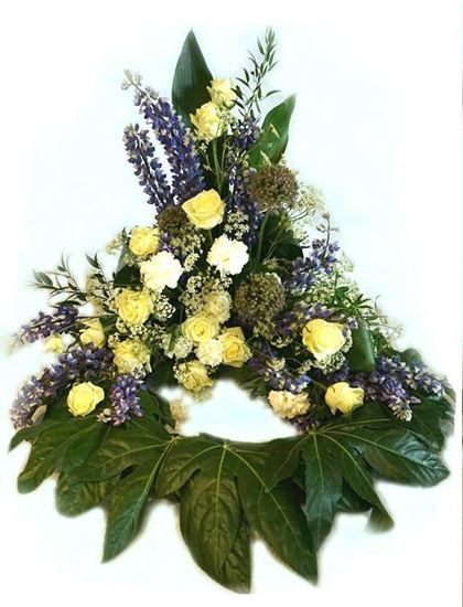 Picture of Danish style of Funeral Wreath standing on the floor with blue, white, cream flowers. 3 sizes