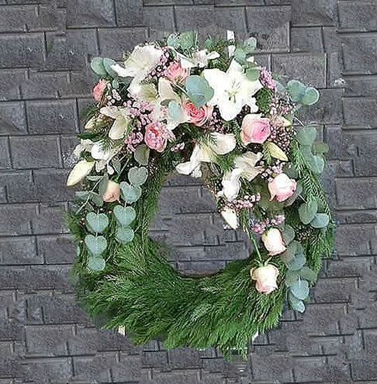 Picture of Funeral Wreath with one decoration with white oriental lilies, pink roses, eucalyptus -3 sizes.
