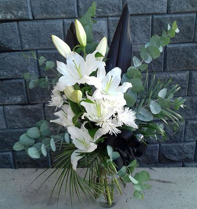 Picture of Oriental lilies bouquet with moms, pastel blue eucalyptus, palm leaves.