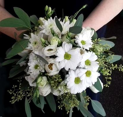 Picture of Wedding bouquet in white colors-eustoma, tulips, chrysanthenum, eucalyptus and more.