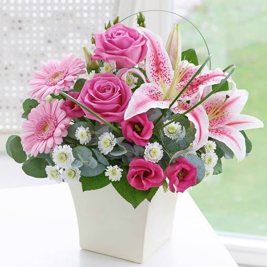 Picture of Mix of gerbera, lilies, roses and greenery arranged in a  ceramic vase (included).