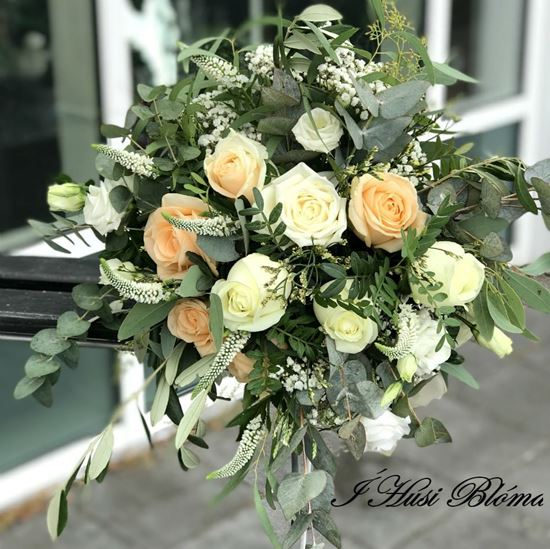 Picture of Bohemian wedding bouquet in pastel shades of blush pink, ivory and white.