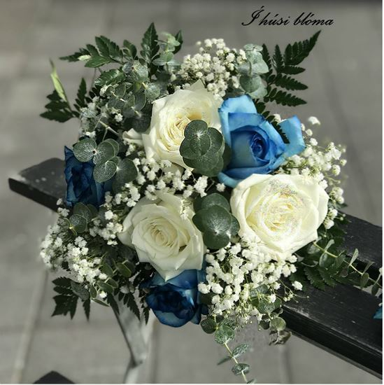 Picture of Wedding bouquet with blue and cream roses accented with baby breath and more.