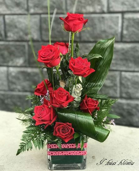 Picture of Romantic upright  red roses arrangement in oasis foam (glass vase included).
