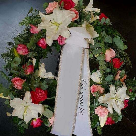 Picture of Funeral Wreath with white and pink blooms elegantly arranged in 3 groupings -3 sizes.