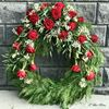 Picture of Peaceful Funeral Wreath with one decoration with red roses, baby's breath and more-3 sizes.