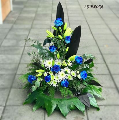 Picture of Danish style of Funeral Wreath standing on the floor with white lilies, blue roses and more- in 3 sizes.