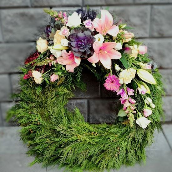 Picture of Funeral Wreath with one decoration with pink lilies, peach roses, snapdragons and more -3 sizes.