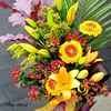 Picture of Autumn colored bouquet with orange lilies, gerbera, berries and more.