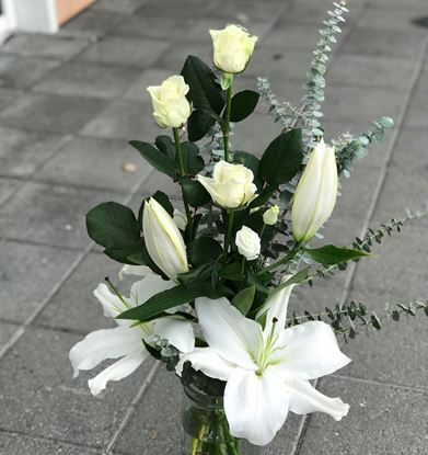 Picture of An elegant all white blooms with roses and white oriental lilies bouquet.