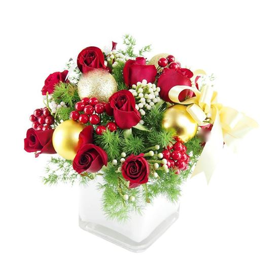 Picture of Christmas flower arrangement with red roses, berries and more in ceramic vase.