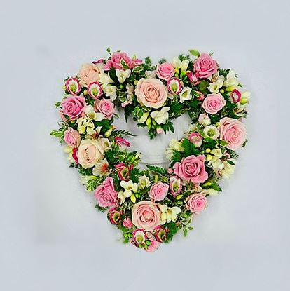 Picture of Open Funeral heart with white and pink flowers-roses, eustoma, greenery and more- 2 sizes.