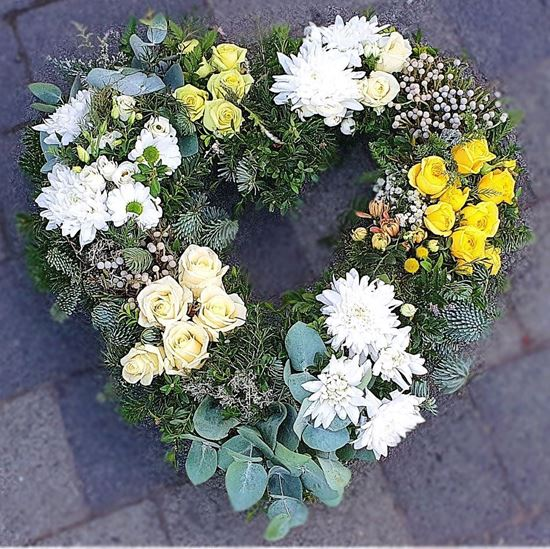 Picture of Winter rustic open Funeral heart arrangement with all kind of flowers and greenery- 2 sizes.