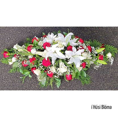 Picture of A classic casket spray cover with red and white roses, white oriental lilies, baby's breath and more-2sizes.
