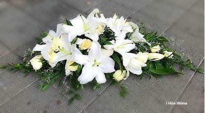 Picture of An elegant all white flowers casket spray in 3 sizes and possibility of different colors.